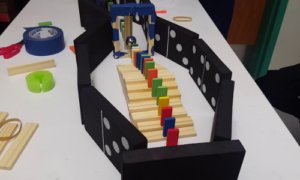 Dominos set up in as a rube goldberg machine